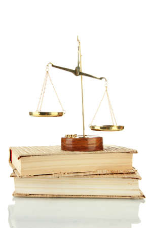 Gold scales of justice and books isolated on white photo