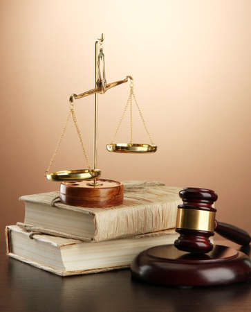 Golden scales of justice, gavel and books on brown background Stock Photo - 17256797