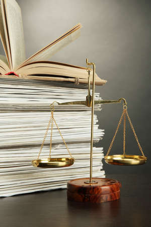 Gold scales of justice and folders on grey background photo