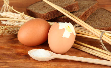 Boiled eggs on wooden background photo