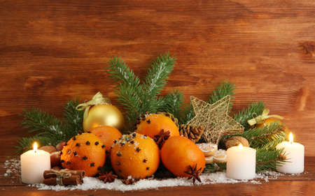 christmas composition with oranges and fir tree, on wooden background Stock Photo - 17264035