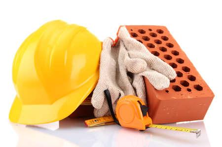 helmet, roulette, bricks and gloves isolated on white Stock Photo - 17263489