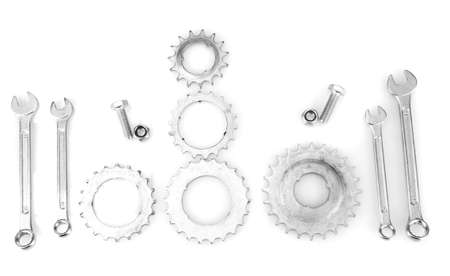 Machine gear, metal cogwheels, nuts and bolts isolated on white Stock Photo - 17263285