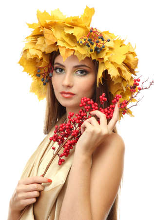beautiful young woman with yellow autumn wreath and red berries, isolated on white photo