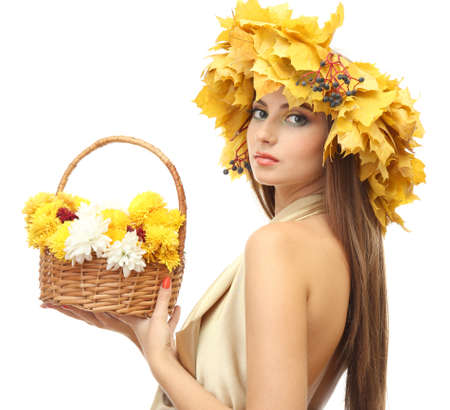 beautiful young woman with yellow autumn wreath and basket with flowers, isolated on white photo