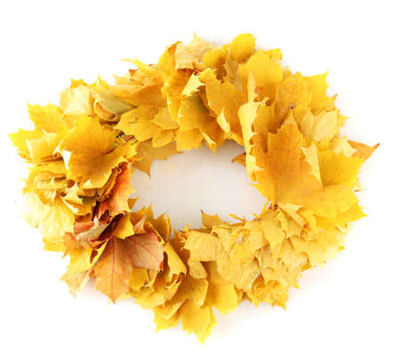 Wreath of yellow leaves isolated on white photo