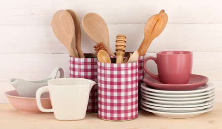 Cups, bowls nd other utensils in metal containers isolated on light background Stock Photo - 17263643