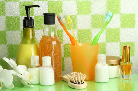 Bath accessories on shelf in bathroom on green tile wall background Stock Photo - 17263965
