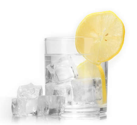 Ice cubes in glass with lemon isolated on white photo