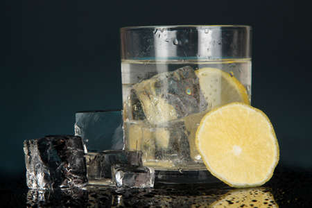 Ice cubes in glass with lemon isolated on black Stock Photo - 17263909
