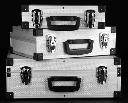 Silvery suitcases on black background Stock Photo - 17264030