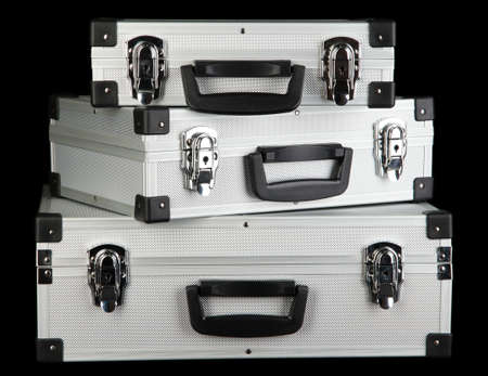 Silvery suitcases on black background Stock Photo - 17264048