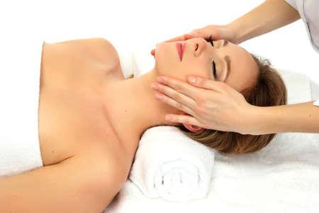 Portrait of beautiful woman taking head massage photo