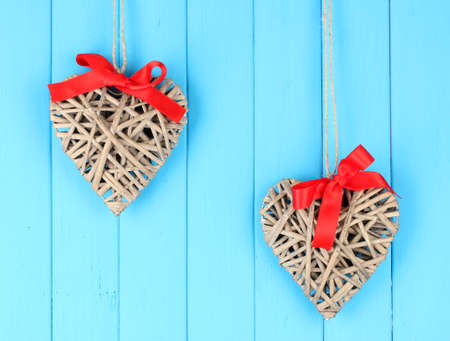 Wicker hearts with red bow on wooden background Stock Photo - 17263732