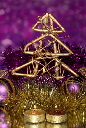 Christmas composition  with candles and decorations in purple and gold colors on bright background photo
