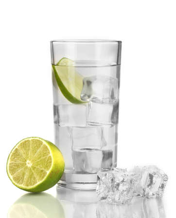 Ice cubes in glass with lime isolated on white photo