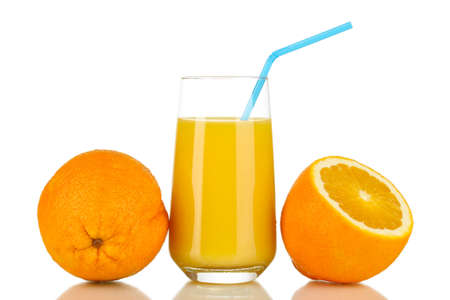 Delicious orange juice in glass and oranges next to it isolated on white photo