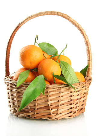 Ripe sweet tangerine with leaves in basket, isolated on white Stock Photo - 17263415