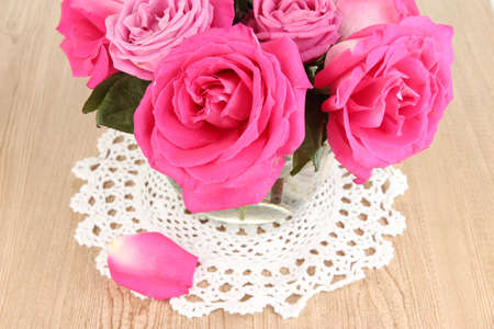 Beautiful pink roses in vase on wooden table close-up Stock Photo - 17264027