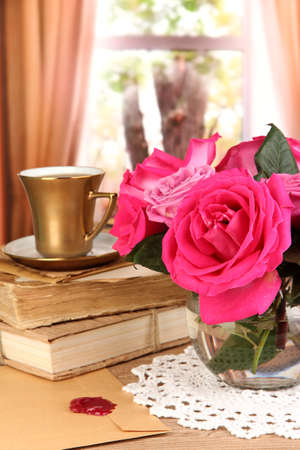 Beautiful pink roses in vase on wooden table on window background Stock Photo - 17264003