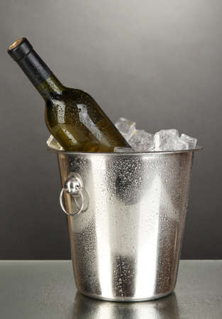 Bottle of wine in ice bucket on black background Stock Photo - 17264114