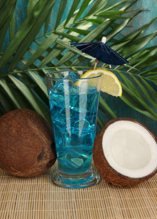 Blue Lagoon cocktail with coconut on tropical background Stock Photo - 17264089