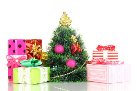 Decorated artificial Christmas Tree isolated on white photo