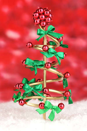 Wire Christmas tree on bright background photo