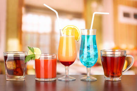 Several glasses of different drinks on bright background Stock Photo - 17263742