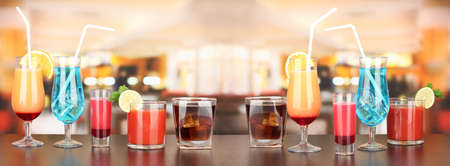 Several glasses of different drinks on bright background Stock Photo - 17264206