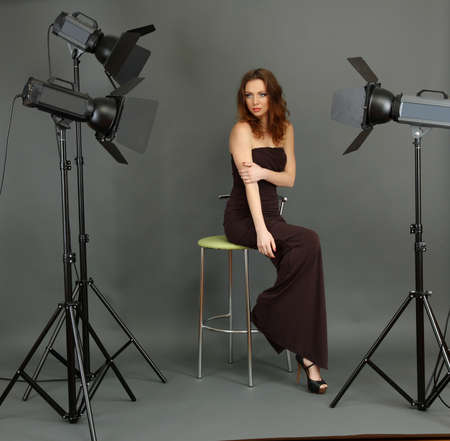 beautiful professional female model resting between shots in photography studio shoot set-up Stock Photo - 17545190