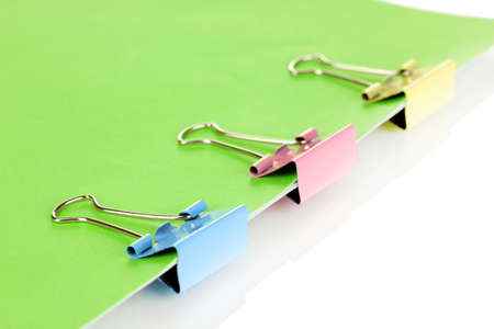 Green paper with binder clips close up photo