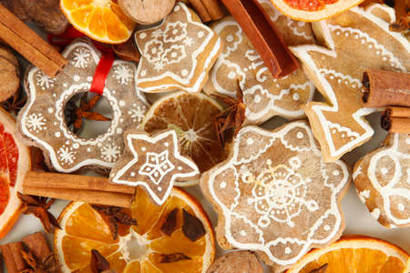 Dried citrus fruits, spices and cookies close-up background photo