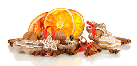 Dried citrus fruits, spices and cookies isolated on white photo