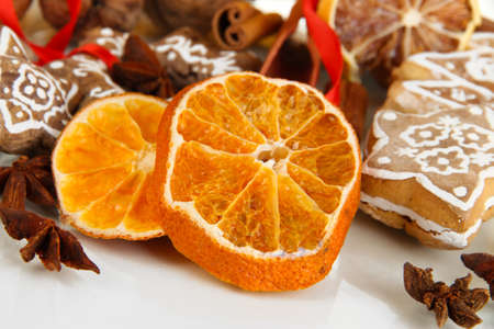 Dried citrus fruits, spices and cookies isolated on white Stock Photo - 17264049