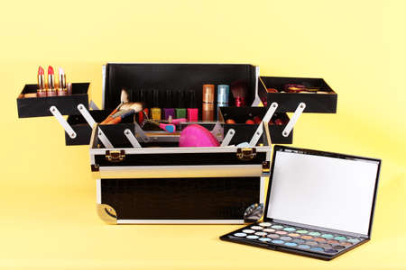 open case with cosmetics on yellow background Stock Photo - 17263641