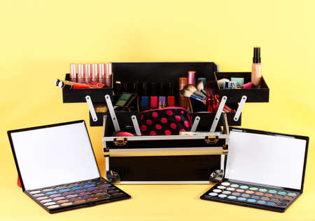 open case with cosmetics on yellow background Stock Photo - 17263573