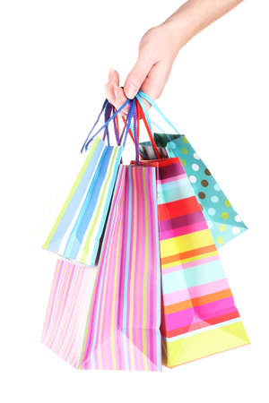 bright gift bags in hand isolated on white Stock Photo - 17291504