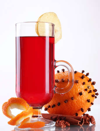 mulled wine in the glass, spice and orange isolated on white Stock Photo - 17291570