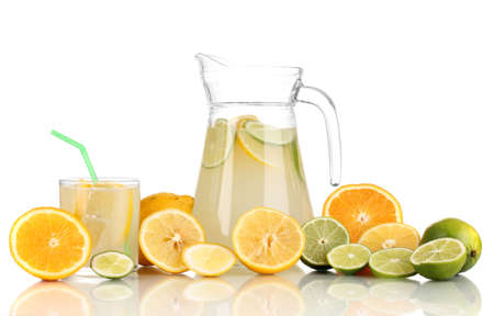 Citrus lemonade in pitcher and glass of citrus around isolated on white Stock Photo - 17291275