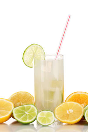 Citrus lemonade in glass of citrus around isolated on white photo