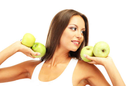 beautiful young woman with green apples, isolated on white photo