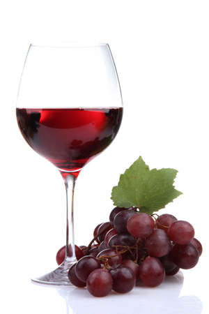 glass of wine and grapes, isolated on white photo