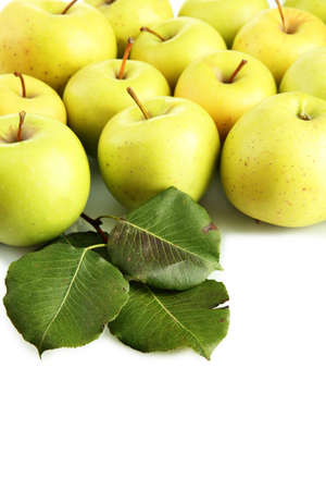 juicy apples with green leaves, isolated on white photo