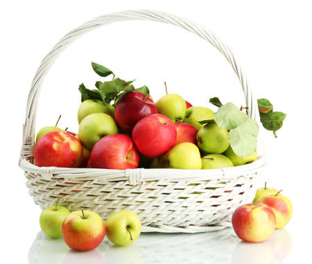 juicy apples with green leaves in basket, isolated on white Stock Photo - 17291454