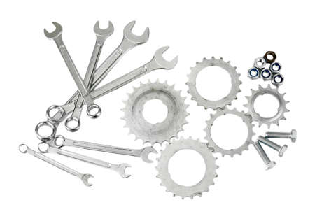 Machine gear, metal cogwheels, nuts and bolts isolated on white Stock Photo - 17291421