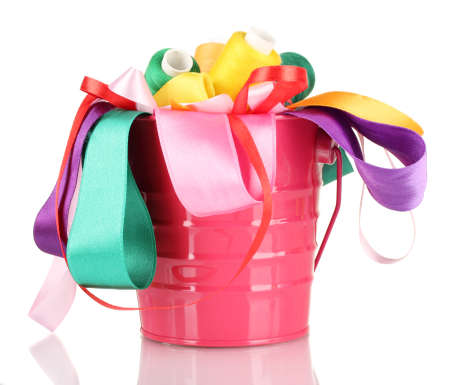 Color bucket with multicolor ribbons and thread isolated on white Stock Photo - 17291435