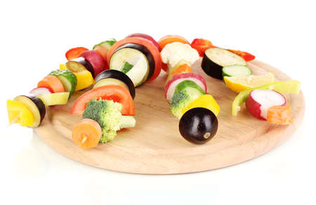 Sliced vegetables on wooden picks isolated on white photo