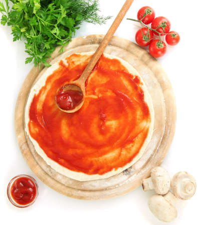 Pizza dough with tomato sauce on wooden board isolated on white Stock Photo - 17291931
