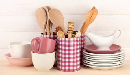 Cups, bowls nd other utensils in metal containers isolated on light background Stock Photo - 17291776